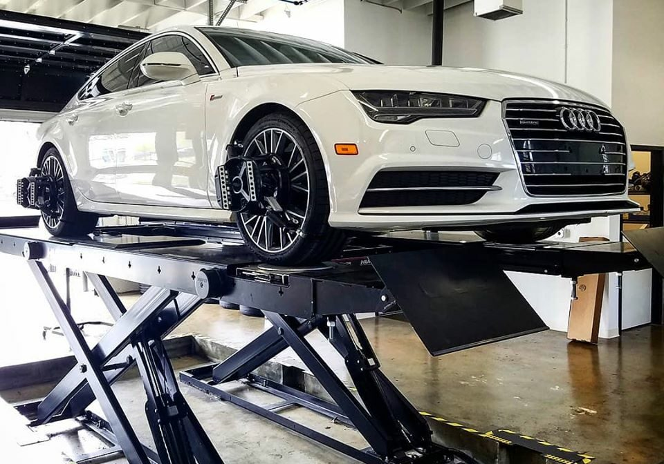 a mechanic works on an audi in an audi service center